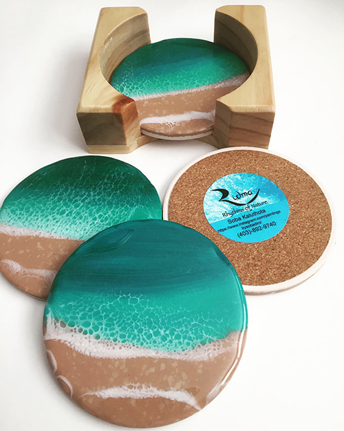 coasters painted with a beach scene