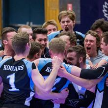 The Kodiaks men's volleyball team celebrates a victory at the 2019 ACAC championships.