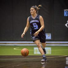 Kodiaks athlete Juhee Anderson moves the ball up court in ACAC action