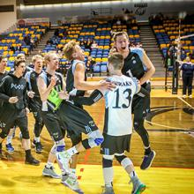 The Kodiaks men's volleyball team celebrates a point in ACAC action