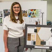 Student Lina Wiebe, shown with her home design, was nominated for an industry award for her design.