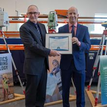 Lethbridge College's Bill Smienk accepts an accreditation certificate for the Geomatics Engineering Technology program from Technology Accreditation Canada's Richard Stamper.
