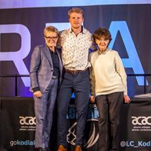 Dax Whitehead of the Kodiaks team of the year men's volleyball team, with Dr. Paula Burns and Flora Matteotti.
