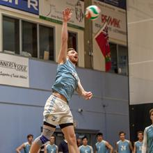 Kodiaks player Carter Hansen goes up for a serve in ACAC volleyball action.
