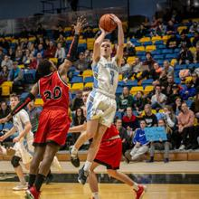 ACAC men's basketball Player of the Year Brock Dewsbery goes up for a shot in a game against SAIT.