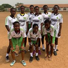 Students in Ghana wearing donated Lethbridge College Kodiaks jerseys.