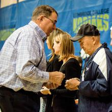 Tim Tollestrup presents Alvin Tietz with his Kodiaks Hall of Fame pin at the 2017 induction ceremony.