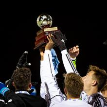 The Lethbridge College Kodiaks men's soccer team celebrates its 2019 ACAC championship.