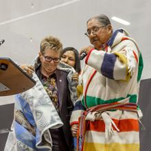 Dr. Paula Burns receives a Blackfoot name from Peter Weasel Moccasin
