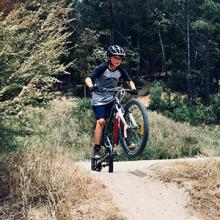 A boy mountain biking.