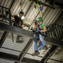 Wind Turbine Technician students practice rapelling from the college's TEAM-1 training platform.