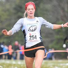 Kodiaks runner Sophia Nowicki crosses the finish line to win the 2018 CCAA national cross country championship.