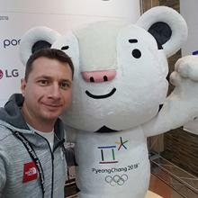 Lethbridge College instructor and South Korean bobsled coach Florian Linder with Olympic mascot Soohorang