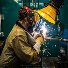 A Lethbridge College welding student works in the college's Welding Lab.