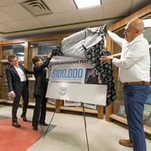Paula Burns, Flora Matteotti and Todd Caughlin unveil a $100,000 gift from Val and Flora Matteotti